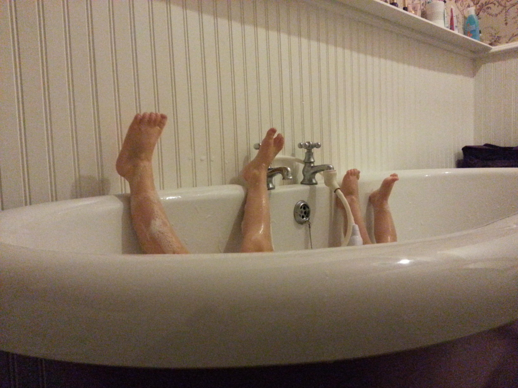baby feet up the wall in bath