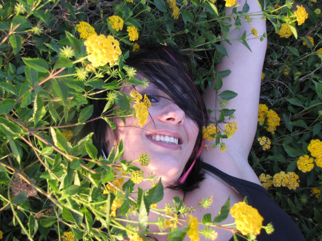 woman-happy-in-flowers